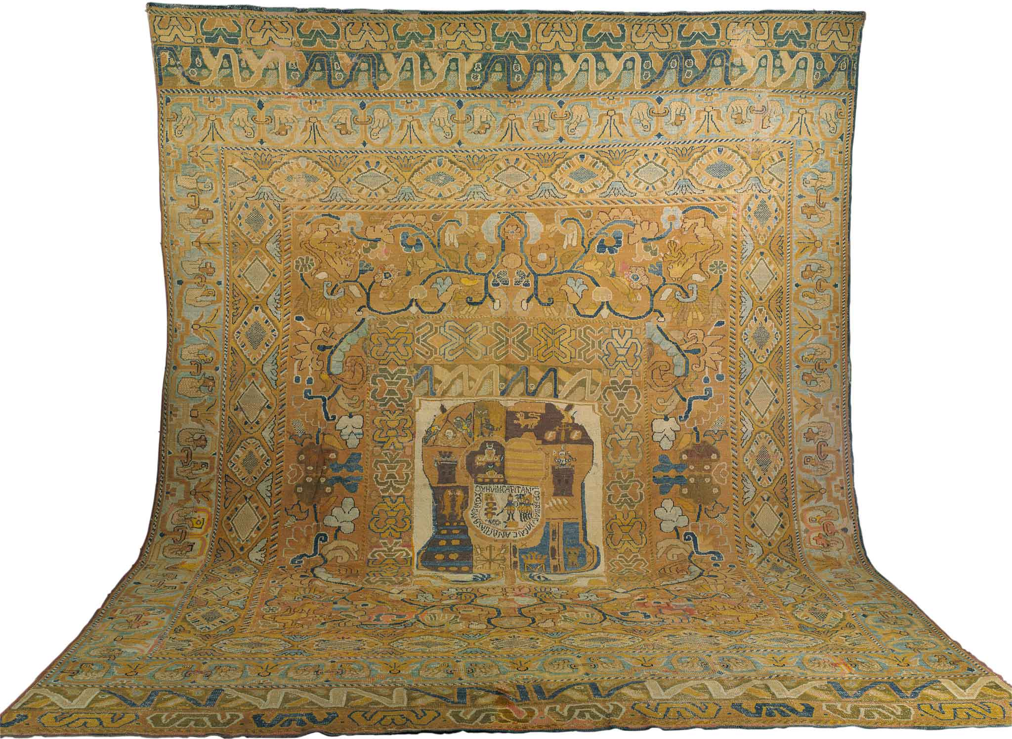 "An early 17th century Portuguese Armourial Carpet from the Doris Duke Collection. Sized approximately 19'5"" x 14'10"". Sold at auction by Christie's for $80,500 (USD) including premium."