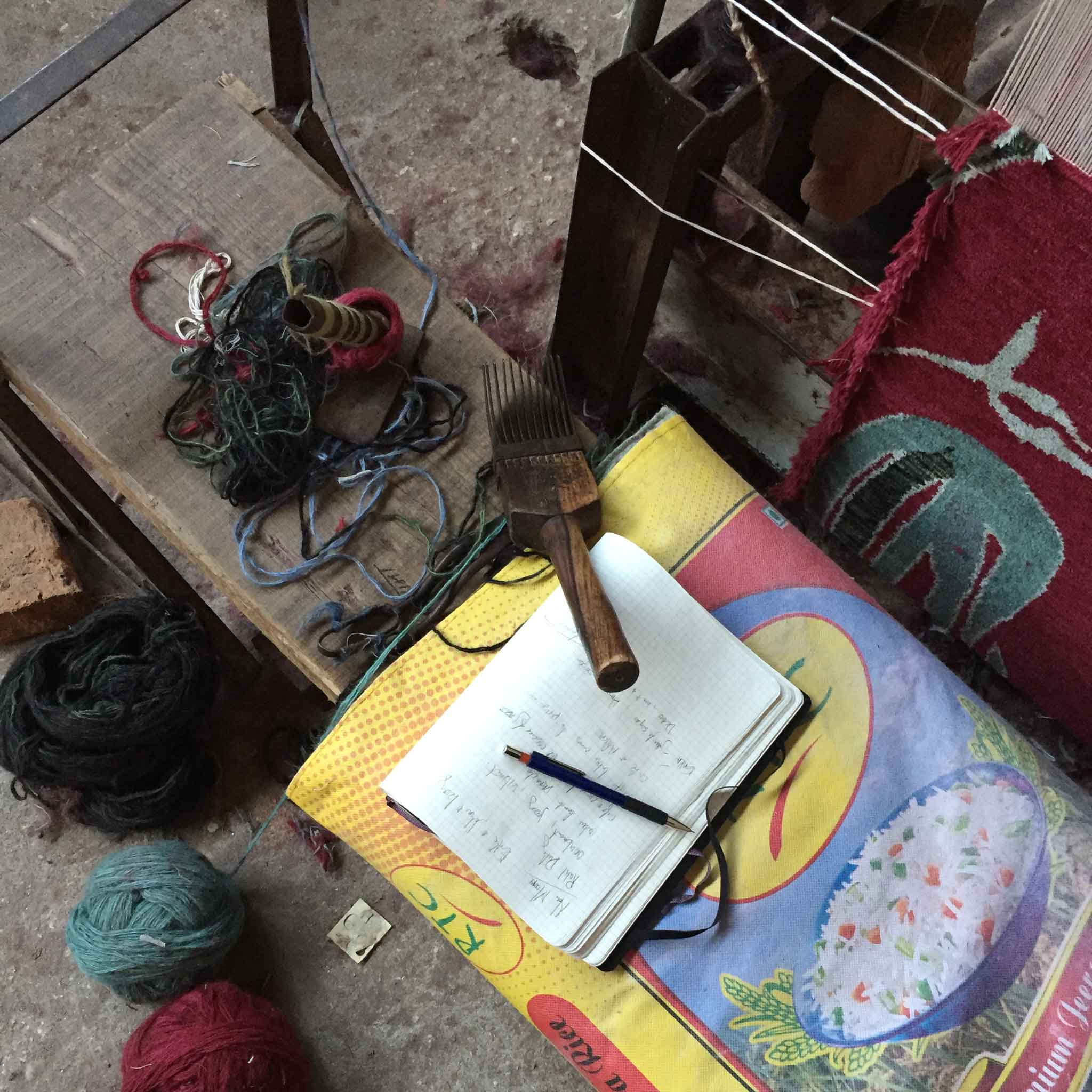 An impromptu and non-staged still life in which writer meets weaver. 'Camara' in colour 'Oxblood' by New Moon is visible on loom at the right. | Image courtesy of The Ruggist.