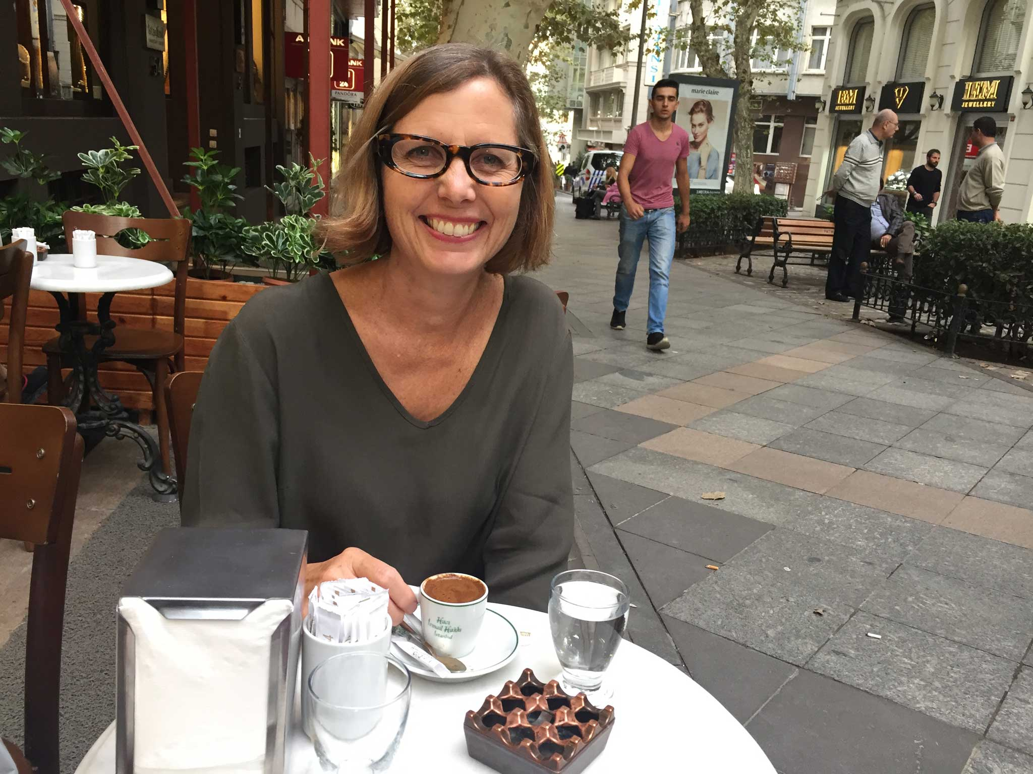 Carol Sebert, President of Creative Matters enjoys a cup of Turkish Coffee during the Inaugural Istanbul Carpet Week. Carol presented 'Contemporary Carpet Design' at the Istanbul International Carpet Conference, 6 October 2016. | Image courtesy of The Ruggist.