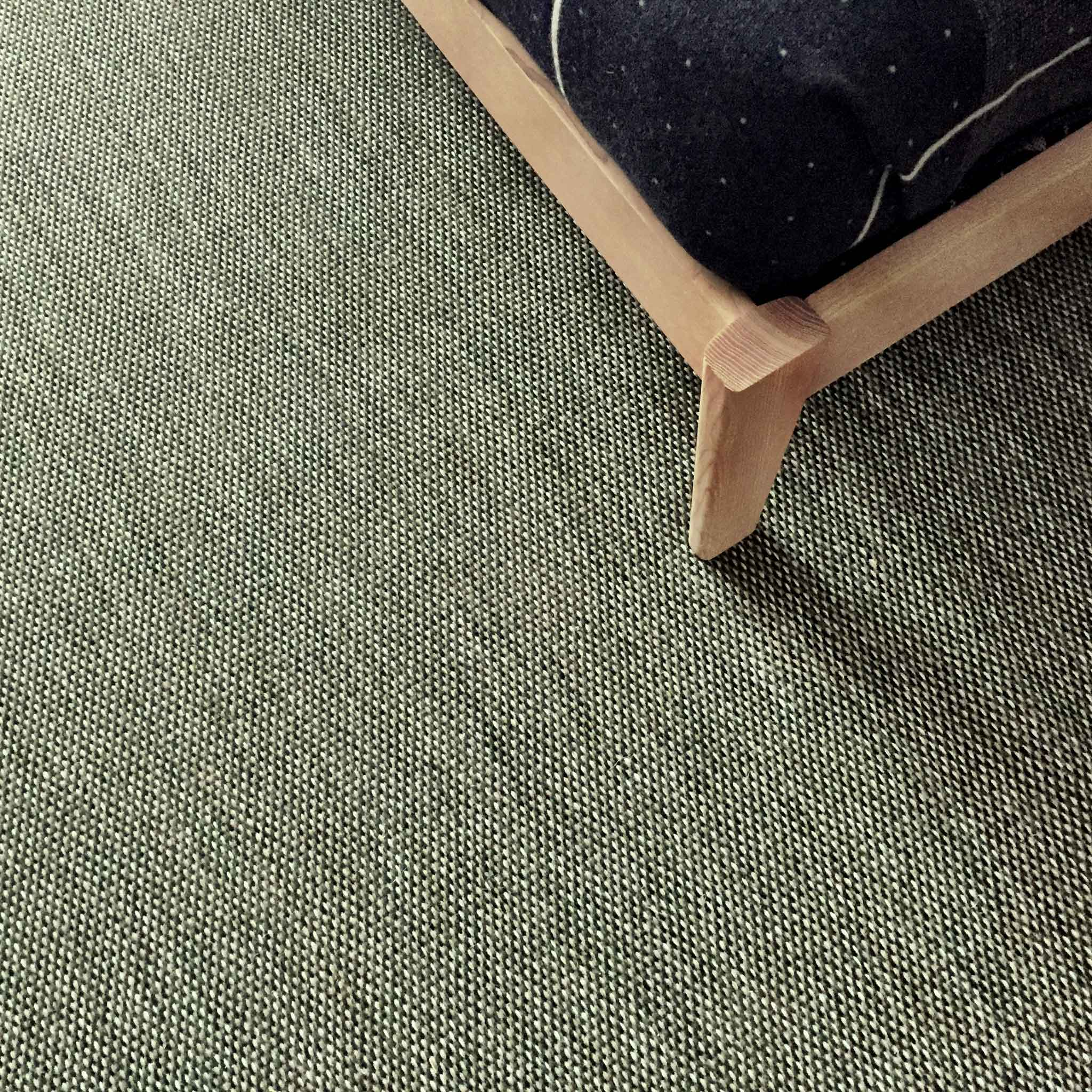 'Tripple' by Kasthall shown in detail. Woven in 100% wool on a linen warp, the character arrises from three different yarn blends that form a marble effect on the subtle, finely patterned surface. | Image by The Ruggist.