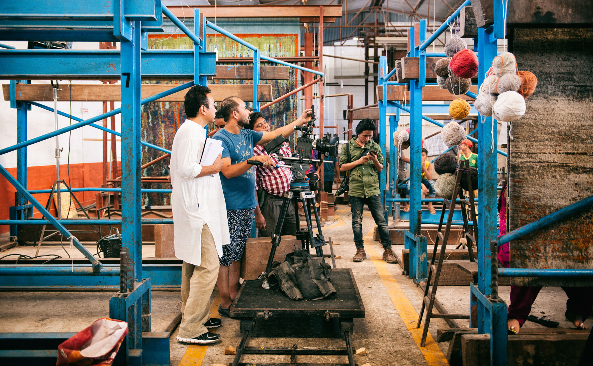 Director Tsering Rhitar Sherpa (left) readies for filming of a weaving scene in 'Nine Million Stars.'   Image courtesy of Jan Kath.