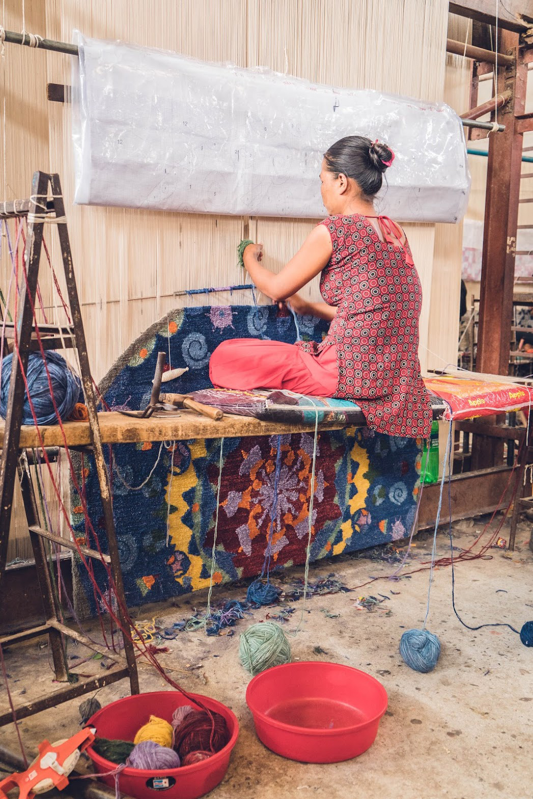 One of the rugs designed as part of the Crossroads and Avenues project launched by Kyle and Kath - Jan Kath Design is shown here on loom in Kathmandu, Nepal. | Image courtesy fo Kyle and Kath.