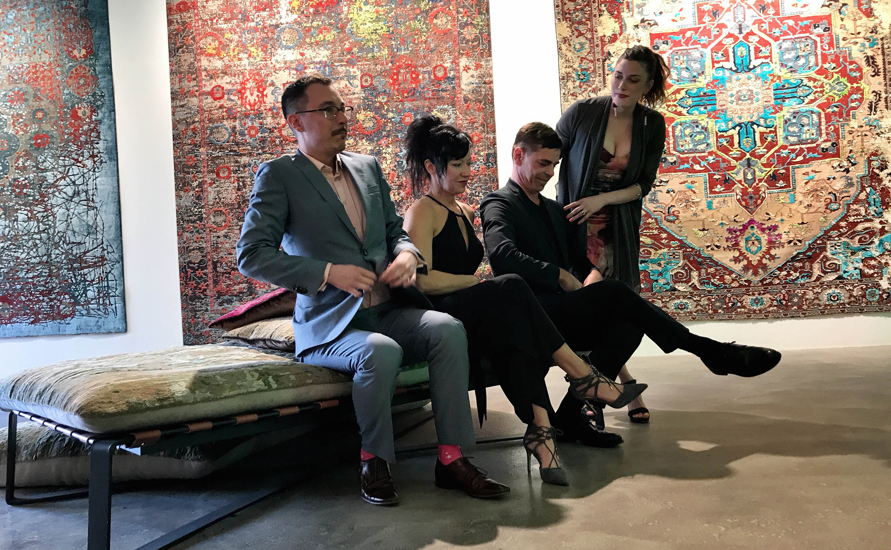 Yvan Semenowycz, Jenni Finlay, Jan Kath, and Robyn Waffle (left ot right) shown primping before the official photographer, Nancy Kim, snapped the group photo just as the opening party for Finlay and Kath's new Jan Kath Toronto showroom got underway on Thursday, 10 May 2018.   Image by The Ruggist.